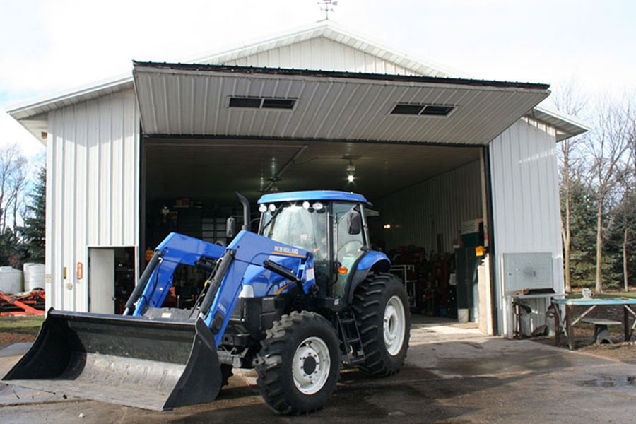 bifold door blue tractor white shed