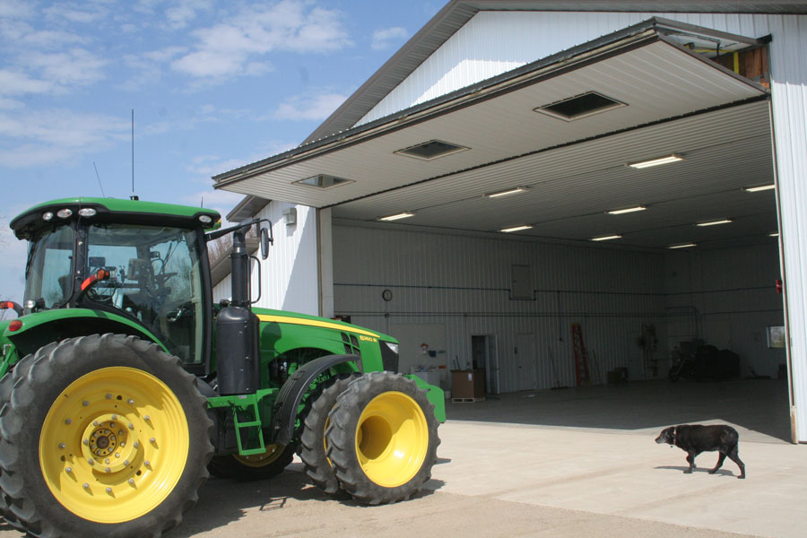 bifold door for a tractor