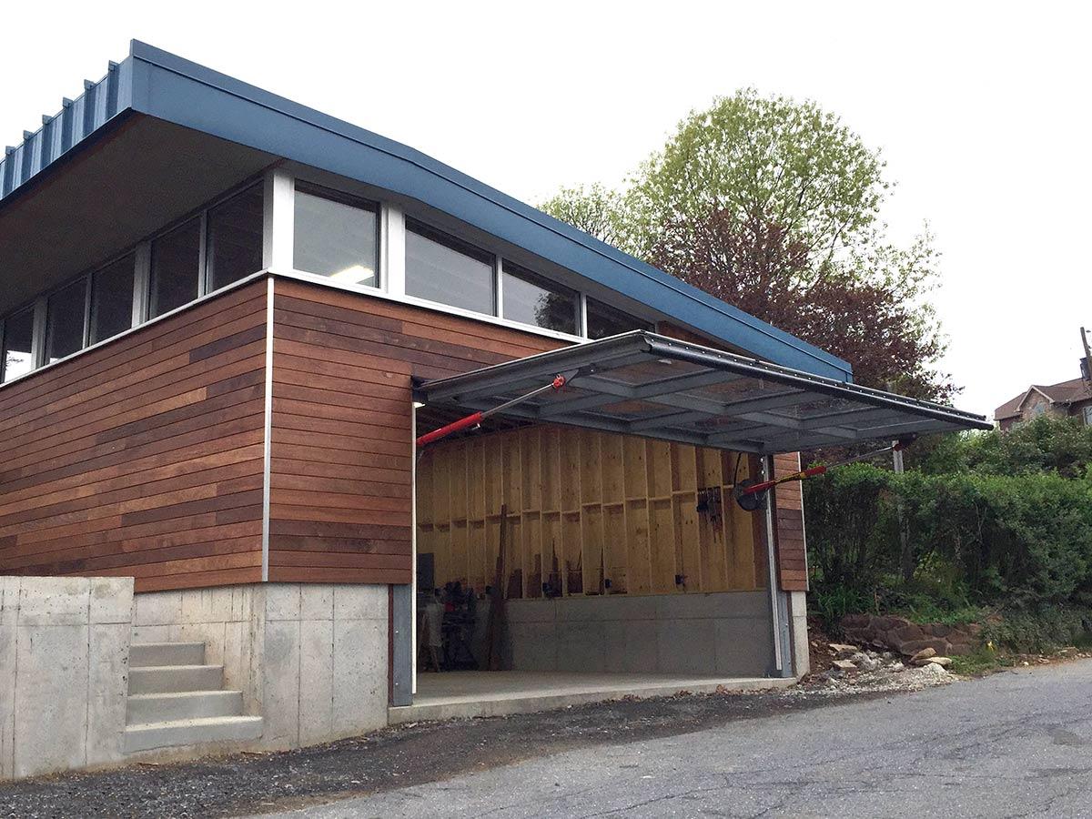 glass stadium bifold kings hidden bifold rv garage door - Bifold Garage Door