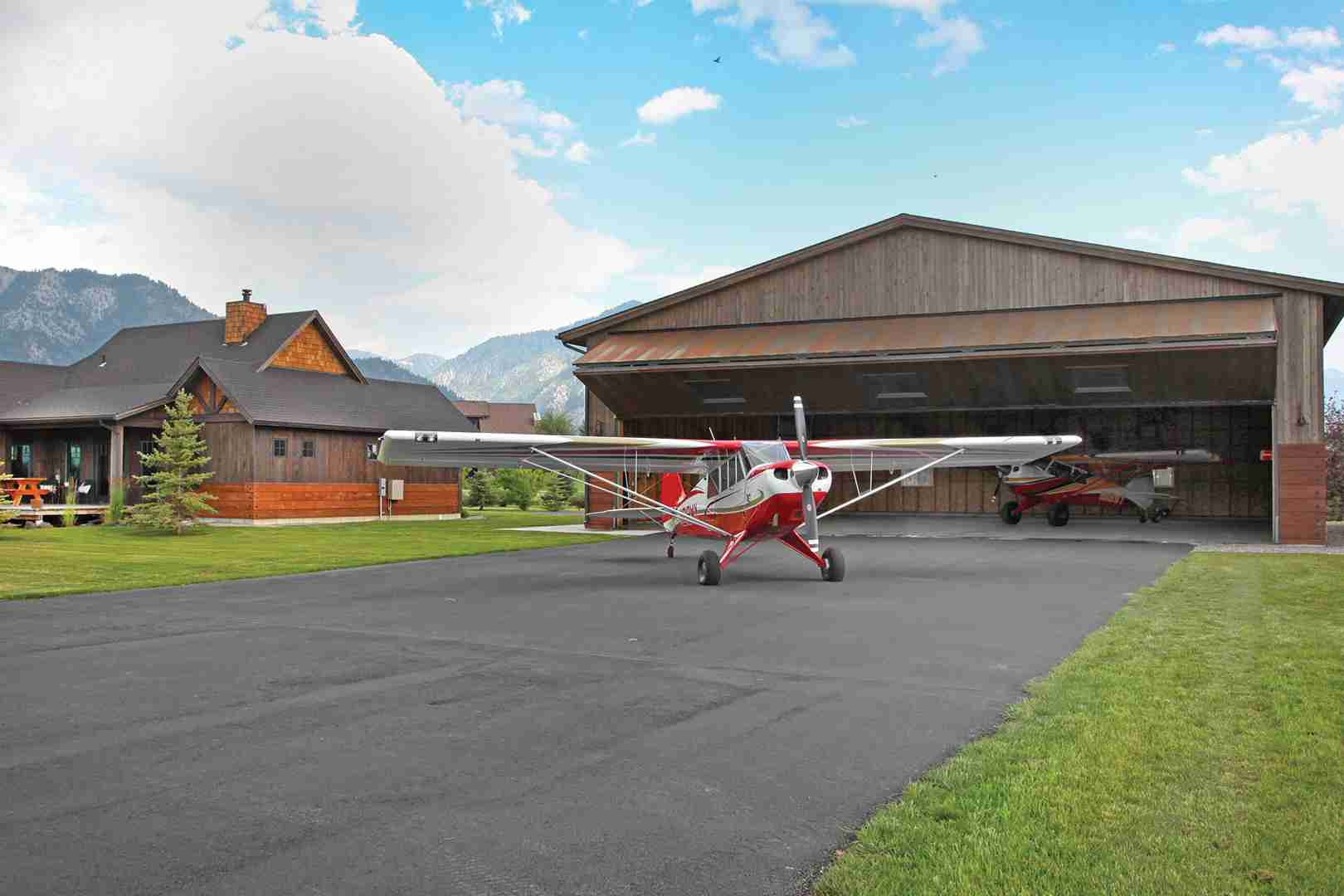 rural hangar plane in front of bifold door