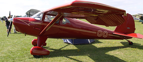 red luscombe plane on the grass