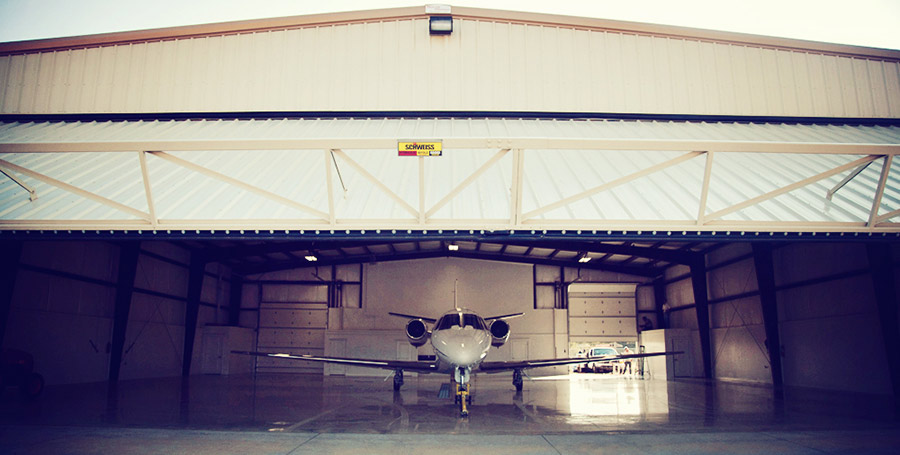 Plane in hangar with hydraulic door, looking in