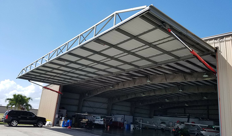 One-piece hydraulic hangar door & Why Hydraulic - Florida Door Installer
